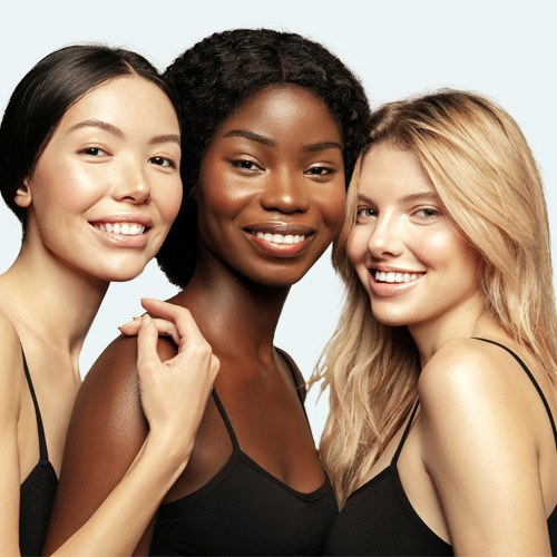 Multi Ethnic Group of three young women with diffrent types of skin together and looking on camera, smiling | Microneedling